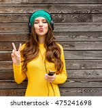 cool girl having fun listens... | Shutterstock . vector #475241698