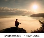 man tourist  sit on rock empire....   Shutterstock . vector #475242058