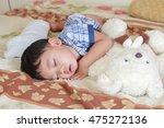 little boy sleeping in his bed. | Shutterstock . vector #475272136