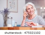 positive senior woman talking... | Shutterstock . vector #475321102