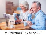 cheerful couple resting in the... | Shutterstock . vector #475322332