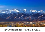 snow capped mountains over... | Shutterstock . vector #475357318