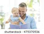 dad and baby reading a book | Shutterstock . vector #475370536
