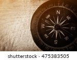 compass on wooden table in... | Shutterstock . vector #475383505