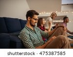 man texting on a mobile phone. | Shutterstock . vector #475387585