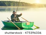 man fishes in the lakes of the... | Shutterstock . vector #475396336