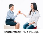Small photo of Patient is receiving healthy alimentation from young doctor - isolated on white.