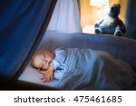 Adorable Baby Sleeping In Blue...