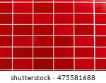 A Red Tiled Background With...