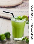 Small photo of ambarella juice, popular fresh drink in south east asia served with lime