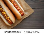 Stock photo barbecue grilled hot dog with yellow mustard and ketchup on wooden table 475697242