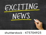 exciting news written on a... | Shutterstock . vector #475704925