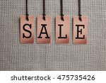 sale labels on fabric background | Shutterstock . vector #475735426