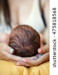 mother holding head of her... | Shutterstock . vector #475818568