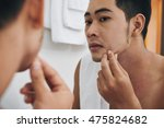 young man looking at pimple on... | Shutterstock . vector #475824682