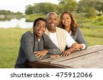 happy family with teenage child. | Shutterstock . vector #475912066
