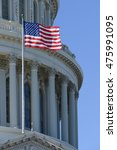 Stock photo us capitol dome detail with waving national flag 475991095