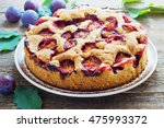 Rustic Plum Cake On Dark Woode...