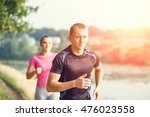 young athletic people jogging... | Shutterstock . vector #476023558