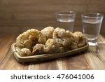 crispy pork skin torresmo with... | Shutterstock . vector #476041006