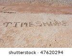 "Inscription ""TimeShare"" on a sand. - stock photo"