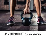 kettlebell training in gym | Shutterstock . vector #476211922