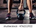 kettlebell training in gym | Shutterstock . vector #476211922