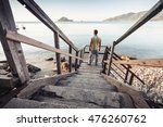Young Man Stands On Old Wooden...