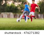 young boys playing football... | Shutterstock . vector #476271382