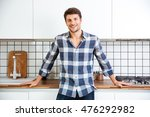 cheerful young man in checkered ... | Shutterstock . vector #476292982