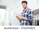 smiling young man in checkered... | Shutterstock . vector #476293825