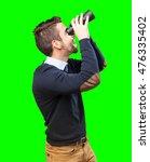 man looking through binoculars | Shutterstock . vector #476335402