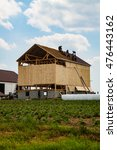 "Small photo of Wakefield, PA - June 24. 2010: Called a ""barn raising"", Amish farmers construct a barn in a day in Lancaster County."