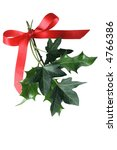 Christmas holly and ivy tied with red ribbon. - stock photo