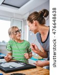 art teacher helping a student... | Shutterstock . vector #476648638