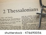 """Small photo of CHIANGMAI, THAILAND, August 31,2016. Reading The New International Version of the Holy Bible on the book of """" 2 thessalonians """" with the holy cross on table at home"""