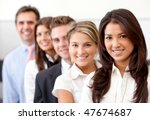 group of business people smiling in an office - stock photo