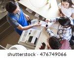 waiter giving receipt to woman...   Shutterstock . vector #476749066