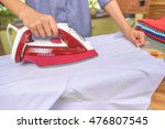 the woman to iron the clothes... | Shutterstock . vector #476807545