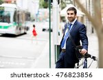 young businessmen with a bike | Shutterstock . vector #476823856