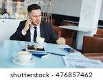 businessman calling in cafe | Shutterstock . vector #476857462
