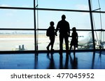 Silhouette Of Father And Two...