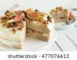 sliced fig walnut cake on plate.... | Shutterstock . vector #477076612