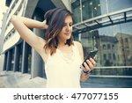 young women using a smartphone | Shutterstock . vector #477077155