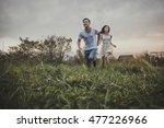 loving couple running outside   Shutterstock . vector #477226966