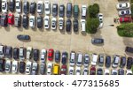 Aerial view full cars at large outdoor parking lots in Houston, Texas, USA. Outlet mall parking congestion and crowded parking lot, other cars try getting in and out, finding parking space. Panorama - stock photo