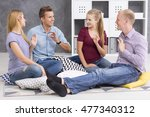 group of four young people... | Shutterstock . vector #477340312