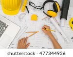 hand over construction plans... | Shutterstock . vector #477344926