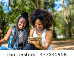 afro women using tablet... | Shutterstock . vector #477345958