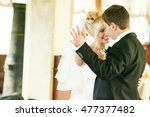 bride smiles while dancing with ... | Shutterstock . vector #477377482